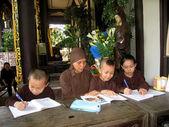 Monk teachs the child in pagoda — Stock Photo