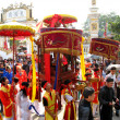 Stock Photo: Group of people in traditional costume palanquin procession of h
