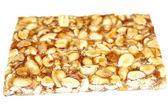 Peanut brittle isolated on white background — Stock Photo