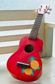 Red Ukulele guitar — Stock Photo