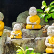Stone-carved little monk — Stock Photo