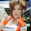 Unidentified females presenter at Hyundai booth — Stock Photo