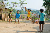 An unidentified children playing Kra Dod Cheark (the rope jumpin — Stock Photo