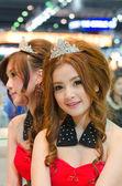 Unidentified females presenter at Mitsubishi booth — Stock Photo
