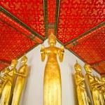 Standing golden Buddha statues — Stock Photo