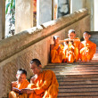 An unidentified monks teaching young novice monks — Stock Photo