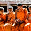 Unidentified monk teaching young novice monks — Stock Photo #33548813
