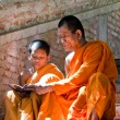 Unidentified monk teaching young novice monks — Stock Photo #33548817