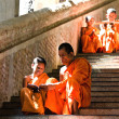 Unidentified monks teaching young novice monks — Stock Photo #33548911