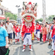 Stock Photo: Unidentified people celebrate with chinese lion