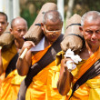 Row of Buddhist hike monks on streets — Stock Photo