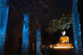 Buddha statue in Sukhothai Historical Park (light painting techn — Stock Photo