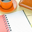 Notebook with leather wallet  and cup of coffee  — Stock Photo