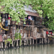 Slum on dirty canal — Stock Photo