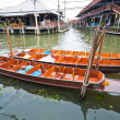 Stock Photo: Wooden flat boats in river at Damoen Saduak floating market