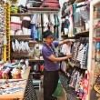 An unidentified  man run a clothing store in Chatuchak market. — Foto de Stock