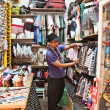 An unidentified  man run a clothing store in Chatuchak market. — Foto Stock