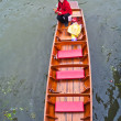Stock Photo: Unidentified womrowing boat at Damoen Saduak floating mark