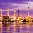 Petroleum oil refinery factory over sunrise — Stock Photo