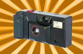 Old compact vintage camera against white background. — Stock Photo