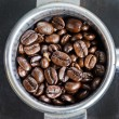 Espresso filter filled with coffee beans — Stock Photo #38324743