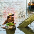 An unidentified Thai woman sells her goods in her boat — Stock Photo #39304233