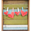 Paper heart hanging on the clothesline. On old wood background. — Stock Photo #39828279