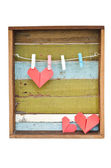 Paper heart hanging on the clothesline. On old wood background. — Stock Photo
