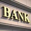 Bank sign on building — Stock Photo