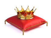 Gold crown on red pillow — Foto de Stock