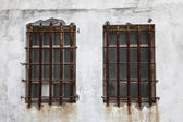 Rusted iron window bars — Stock Photo