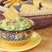 Bowl of guacamole dip with chips. — Stock Photo
