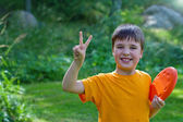 Cute young boy with a frisbee — Stock Photo