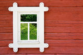 Decorative white window on an old farmhouse wall in Scandinavia — Stock Photo