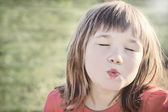 Little girl giving an air kiss — Stock Photo
