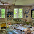 Stock Photo: Adandoned trashed house with graffifi on walls