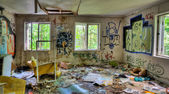 Adandoned trashed house with graffifi on walls — Stock Photo