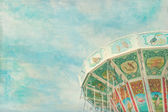 Closeup of a colorful carousel with painterly textured editing — 图库照片