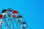 Closeup of a ferris wheel with blue sky — Stock Photo