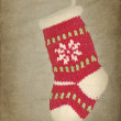 Red Xmas stocking hanging on rustic background — Stock Photo