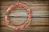Red Christmas wreath on a wooden background — Stock Photo