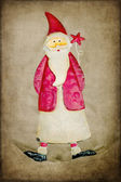 Santa Claus decoration on rustic background — Stock Photo