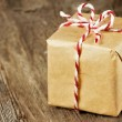 Brown paper package tied up with strings - Stock Photo