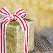 Christmas gift box with a red ribbon — Stock Photo
