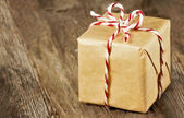 Brown paper package tied up with strings — Stock Photo