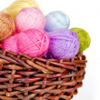 Colorful woolen yarn in a wicker basket — Stock Photo