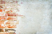 Red brick wall with plastered cement background — Stock Photo
