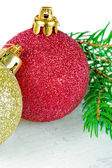 Red and golden Christmas baubles on white background — Stock Photo