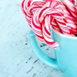 Candy canes in a light blue cup — Stock Photo #13734671