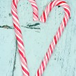 Candy cane heart on a wooden background — Stock Photo